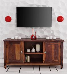 Get transported to a bygone era with the Louis Collection of TV units from Amberville. Inspired by the Louis XVI style of colonial furniture, the collection features classic details like turned fluted legs and dainty detailing like rosette knobs. You can check out a lot more TV unit designs online at Pepperfry