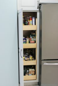 Slideout shelves in a pantry cabinet by @durasupreme installed in a #remodeled #kitchen by Village Home Stores.    |    VillageHomeStores.com