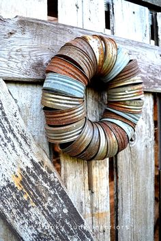 Whip up a rusty canning jar lid wreath in minutes, by Funky Junk Interiors featured on I Love That Junk