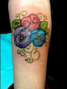 Beautiful pansy flower tattoo by Audrey Mello