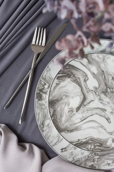 Gunnison is a swirling marble patterned tableware range in cool grey, which when paired with the rest of the Stargaze trend from A by Amara takes on a mesmerising intergalactic feel. Dinner Plate Sets, Dinner Plates, Marble Print, Dining Room Inspiration, Marble Pattern, Luxury Gifts, Stargazing, New Trends, Branding Design