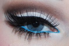 I love the blue liner on the lower lash line. I low the dramatic black winged liner. I love the huge false lashes.