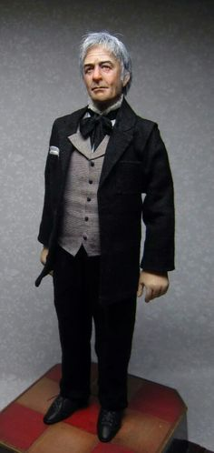 Handsome man doll, looks very lifelike.  Wish I knew the name of the artisan who made him.