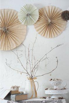 Rustic wedding reception or rehearsal dinner - fan-pleated rosettes on lattice screens behind head table