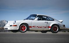 1973 Porsche 911 Carrera 2.7 RS Lightweight to be auctioned off at Pebble Beach. Get pre-approved with Premier Financial Services. #Porsche #PebbleBeach