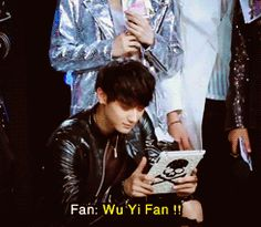 Taoris-Tao being distracted from his game by a fan shouting 'Wu Yi Fan!'