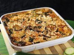 courgette, tomate pelée, feta, ail, oignon, crème fraîche épaisse, lait, oeuf, huile d'olive, origan, sel, poivre