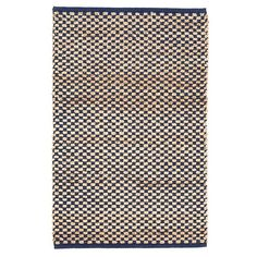 This rug's checkerboard pattern is handwoven with naturally colored jute and navy cotton. Its thick weave not only makes it an ideal textural rug, but it also works great in high traffic areas.  Due to the handmade quality of our rugs, they may vary slightly in size and/or color.Rug pattern is scaled to rug size and may vary from the images shown.  EMAIL FOR AVAILABILITY.