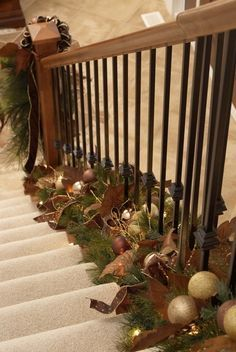 Never thought of decorating the bottom - I like this because it leaves the staircase handrail open for hands! Love these decorations and the colors too! Great idea for Christmas home holiday decor. Noel Christmas, Primitive Christmas, Winter Christmas, Christmas Crafts, Christmas Garlands, Christmas Ideas, Green Christmas, Thanksgiving Holiday, Holiday Ideas