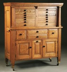 AN OAK DENTAL CABINET early 20th century paneled. This would be great for a sewing or craft  room.