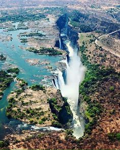 The magnificent Victoria Falls on the Zambezi River at the border of Zambia and Zimbabwe. No words to describe the majesty of this place. Travel inspiration for Victoria Falls, Zimbabwe, Kenya Travel, Africa Travel, Places To Travel, Places To See, Africa Destinations, Travel Destinations, Travel Tourism, Les Continents, Victoria Falls