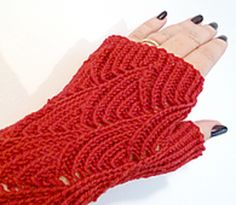 An adaptation of Pomatomus Socks, to make them into fingerless gloves with a thumb gusset. The adaptation is similar to Craftaholic's half-fingers Mermaid Gloves, but with more detail and no fingers. Requires the ability to read charts.