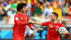 Goals from Marouane Fellaini and Dries Mertens saw a strong Belgium side overturn a 1-0 deficit against Algeria to secure victory at the World Cup.