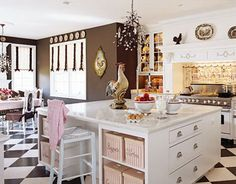 Love this kitchen,  maybe do away with the roster's since that was my moms theme,  and make it flowers or cupcakes,  but I love the look,  layout and the color