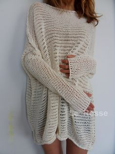 Slouchy / Oversized knit tunic. Loose knitted, relaxed fit. Color is off-white.  Made of 100% unbleached cotton. Please choose your size in your upper right.  Size Small will fit sizes 2-6 US. Size Medium will fit sizes 8-12 US. Sizes Large will fit sizes 14-18 US.  The length is about 28-32 inches depending on the size.   There are thumb holes in the sleeves for easy wearing. If you do not wish thumb holes please let me know when you place an order.   Recommended care : Hand wash and ha...
