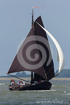 A Botter sailing over the sea. Botters are traditional Dutch sailing ships used to catch fish. The type was first used in the second half of the eighteeth century and was still in use in the 1950's when the modern trawlers appeared. There are various versions, specially built for the region where they were used.