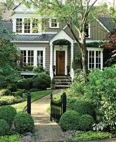Charming cottage style house and entryway garden, love it!