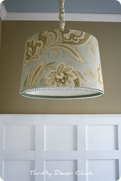 love the drum lampshade and the board & batten walls.