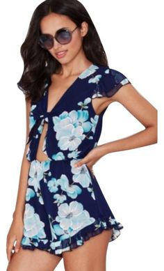 7d16904698b2 Nasty Gal Navy Take A Peek Floral Romper Dress. Free shipping and  guaranteed authenticity on