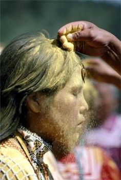 Apache Sunrise Ceremony. To initiate a girl into womanhood, she is blessed with pollen, which symbolizes fertility.   (Photo & Info Courtesy of National Geographic.)