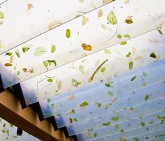 I love how this recycled glass has leaves sandwiched into it.  Perfect for a garden room. -Jeremy... pinned with Pinvolve