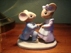 Selling this collectible Enesco mouse figurine of a boy mouse proposing to a girl mouse along with another mouse figurine of two mice lacing an old fashioned ladies shoe. Both figurines for a total of $10. If interested contact me. Follow this link to see photos of both figurines.