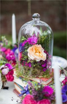 Bright and earthy wedding reception table decor. #weddingflorals #tabledecor #weddingchicks Event Design: Darcey May Events ---> http://www.weddingchicks.com/2014/05/01/alice-in-wonderland-wedding-ideas/