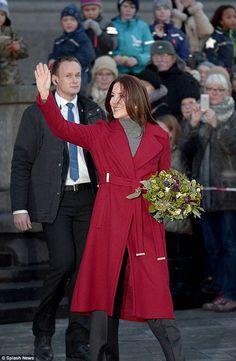 Royal in red:Jolly holiday: The Australian royal attended the event solo to preside over the tree lighting for the 100th anniversary of the annual tradition, dressed in a stunningDiane von Furstenberg coat