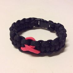 Pink Ribbon Cancer Awareness Paracord Bracelet. Third one, nailed it? :) Now, imagine any color you want with a pink ribbon.... #pink #black #cancer #paracord #paracordlife #paracordbracelet #cancersucks #cancerawareness #ribbon #breastcancerawareness