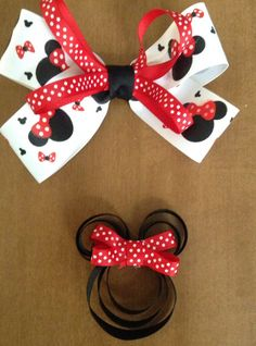 Lg black,white, and red and small black and red Minnie Mouse bows on Etsy, $6.50