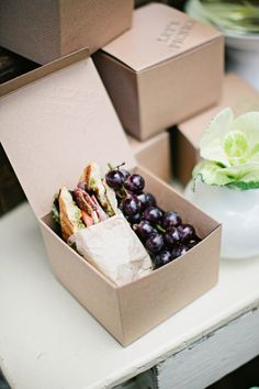 The perfect 'box lunch'.  Tasty sandwich and a little fruit.