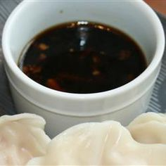 """Gyoza Sauce. """"Use this slightly-spicy Japanese dipping sauce for pot stickers or spring rolls."""" Original recipe makes 2 cupsChange Servings  1/2 cup rice vinegar  1/2 cup low-sodium soy sauce  1/2 teaspoon crushed red pepper flakes  1 garlic clove, minced  1/2 teaspoon minced fresh ginger root  1/3 cup thinly sliced green onions  1 teaspoon sesame oil Gyoza Sauce Recipe, Potsticker Sauce, Sauce Recipes, Dipping Sauce For Dumplings, Spicy Soy Sauce Recipe, Dumpling Sauce, Egg Roll Dipping Sauce, Cooking Recipes, Dipping Sauces"""
