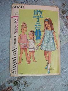 Wonderful Estate Sale find! Vintage 1965 Simplicity Jiffy Printed Pattern Childs Play Clothes – 6039/ Girls' Size 5. 5 Pieces (Previously Cut) With Instructions - Easy Level. Printed in USA. Pattern envelope while still intact is worn, envelope show oblivious signs of wear (showing its age, its over 50 years old!). Skill Level: Easy  From a smoke free, pet free home. Sold as is.  Please feel free to check out some of the wonderful items on sale in my other Etsy Shop Booth58 https:/&...