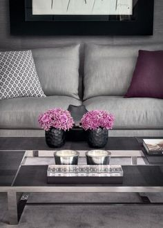 Mismatched but coordinated throw pillows add depth to this sweet gray and purple living room palette