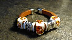 Regaliz Bracelet, Genuine Brown Leather with Handmade Lampwork Flower embedded beads with ivory tone glass Tiny Necklace, Glass Necklace, Surprise Gifts, Handmade Beads, Glass Beads, Cuff Bracelets, Brown Leather, Cuffs, Ivory