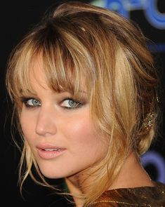 Girl on Fire. Love how pretty her eyes look and the shine in her hair