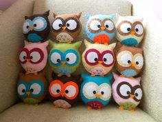 CUTE! You could just make the fronts of them and sew them on a big piece of material and make a pillow!