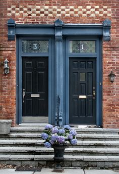 Entrances to victorian terrace homes on Wellesley Avenue in the historic neighborhood of Cabbagetown, Toronto. Another commonly found feature on victorians of Toronto is stained glass that you can find above windows or above doors on the transom as seen here.