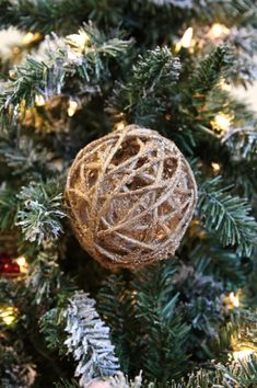 Wrap twine around a small balloon, add some glitter glue and pop the balloon when dried. Great rustic Christmas ornament!