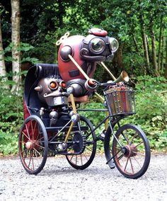 Geweldig ontwerp! Kijk naar de uitdrukking op het gezicht van de voorste robot en zijn houding op de fiets.