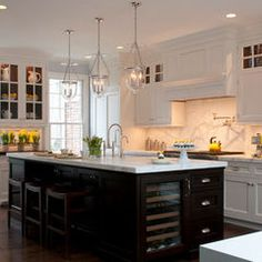 I love the contrast between Island cabinets and home cabinets! Original Pin said:White Kitchen with Dark stained (ebony) sland. Classic white kitchen with dark stained island. New Kitchen, Kitchen Interior, Kitchen Dining, Kitchen Decor, Narrow Kitchen, Kitchen Ideas, Black Kitchen Island, Kitchen Wood, Kitchen Islands