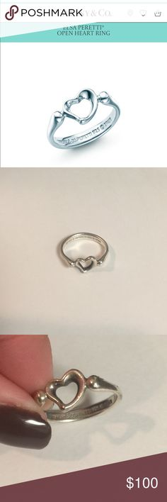 Tiffany and Co Open Heart Ring Sterling silver Tiffany and Co Ring.  This ring has been loved with some wear and tear (tried to get the best pics to show).  Just don't really wear silver anymore so time to find this piece a new home! 💍. Needs a good polish and should be good as new!! I believe this is a size 7.  I tried it on my ring finger which is a 6.5 and it was a tad by too big.  Open to offers but 🚫trades please.  No box/bag. Tiffany & Co. Jewelry Rings