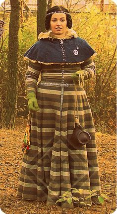Dress made of striped wool with linen lining. Pattern based on Herjolfsnes excavations (two gores on the side). Stripes on each part of the dress match each other. All hand made.
