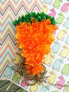 Celebrate spring gardening and the Easter bunny with this simple carrot craft for kids, made from a paper plate and squares of tissue paper.