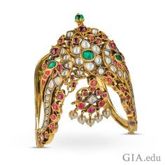 Such a rigid armlet (vanki) was typically worn by idols and dancers in South Indian temples, but the opulence of this piece indicates its use by an aristocrat. Madurai ▪ 19th century ▪ diamond, ruby, emerald and pearl in 22K gold ▪ 10 x 7 x 8.5 cm. Photo by Robert & Orasa Weldon/GIA