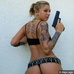 Mmmm gun and tats!!