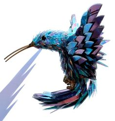 Sean Avery, children's book illustrator and sculptor makes his all sculptures out of recycled materials. This beautiful hummingbird is made of old CD's!