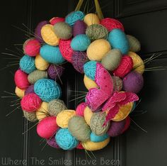 Spring Easter Egg Wreath | Where The Smiles Have Been.  Plastic Easter eggs wrapped in some cheap yarn and glued to a wreath form....instant Spring!