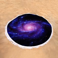 "Purple Pinwheel Galaxy Round Beach Towel by Johari Smith.  The beach towel is 60"" in diameter and made from 100% polyester fabric."