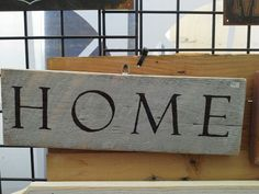 """Home"" on a recycled pallet box board"